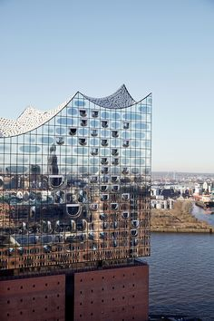 It's six years late but the The Elbphilharmonie concert hall in Hamburg is finally opening to the public. Designed by Herzog & de Meuron the finished building is an impressive sight on the Hamburg waterfront standing tall and with Architecture Antique, Facade Architecture, Beautiful Architecture, Beautiful Buildings, Contemporary Architecture, Monumental Architecture, Jacques Herzog, Glass Facades, Commercial Architecture
