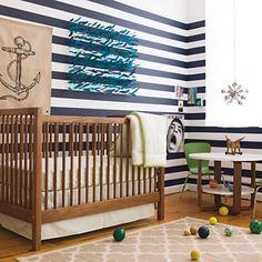 American Walnut Andersen Crib plus a green and navy color scheme equals preppy chic nursery.