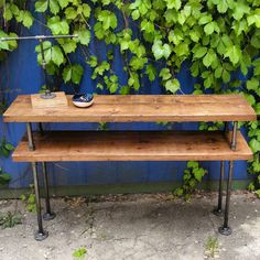 Industrial steel and wood TV Stand || rustic steel pipe wood console table || industrial chic table ||custom steampunk console table by PipeAndWoodDesigns on Etsy https://www.etsy.com/listing/236412268/industrial-steel-and-wood-tv-stand