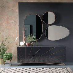 Solaris sideboard with precious and bright pink gold engravings the set of mirrors