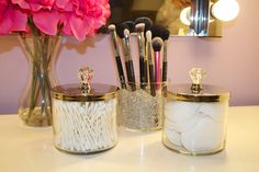 Before you dump out the empty candle pots, check out this super easy DIY. Just hot glue some fancy little drawer knobs to the covers and use to store your toiletries!