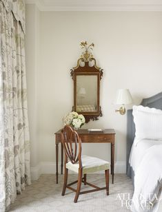 An embroidered botanical by Cowtan & Tout flows from the draperies in the master bedroom.