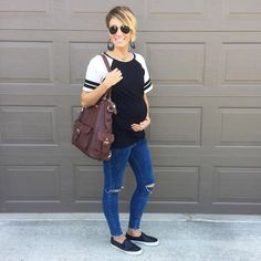 Such a cute casual maternity look. Baseball tee, leather earrings, distressed denim, leather sneakers.