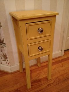 """Small side table, painted in Annie Sloan chalk paint """"Arles"""" with light distressing and new glass knobs."""