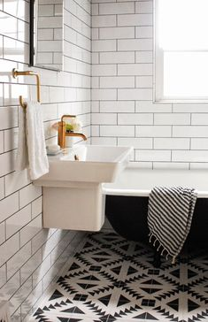 pattern tile floor, great modern bathroom with subway tile and black tub