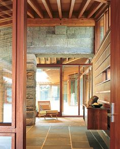 stone flooring and walls + beam ceiling