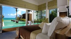 View of a pool and the ocean at the Aleenta Resort & Spa, Phuket Phangnga, Thailand.