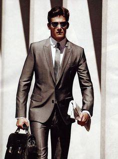 Upscale casual men's style. Dark denim, light shirt and a belt.