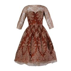 Dreamy 1950s Brown Tulle Chantilly Lace Cocktail Dress   See more vintage Cocktail Dresses at http://www.1stdibs.com/fashion/clothing/evening-dresses/cocktail-dresses in 1stdibs