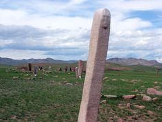 Deer Stone at Uushglin uvur, west of Murun, Mongolia - photo by Dr. Val Farmer, via Musings in Mongolia;  At this site are 15 deer stones, many with pictures of flying deer, some with leopards, antelopes, etc, and one with a man's face toward the top (which is rare). These are from the Bronze Age.