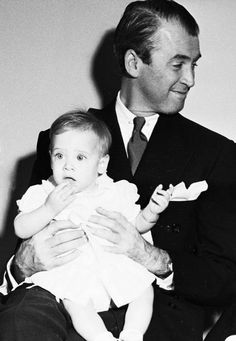 Jimmy Stewart with one of his twin-daughters, 1951