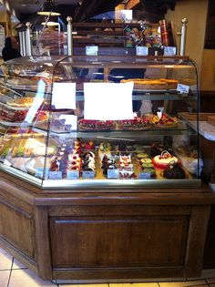Parisian Bakery Display Case.  I love the wooden case and especially the extra covered shelf on the top.