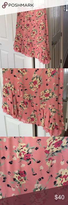 Betsey Johnson peach floral skirt Betsey Johnson floral skirt with asymmetrical trim at bottom and polka dot lining underneath. Size 4. Zipper for closure. Adorable with a black or white top for any spring summer occasion. Betsey Johnson Skirts