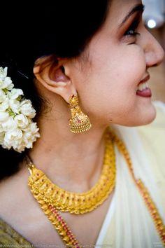 South Indian bride. Temple jewelry. Jhumkis.White Kerala Kasavu sari.Kasavu mundu set.White silk kanchipuram sari.Braid with fresh jasmine flowers. Tamil bride. Telugu bride. Kannada bride. Hindu bride. Malayalee bride.Kerala bride.South Indian wedding
