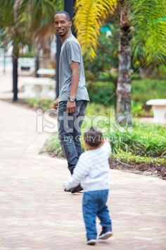 Single dad playing outside with two year old son Royalty Free Stock Photo