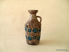 Pitcher vase in stone colored lava glaze with blue by Cherryforest
