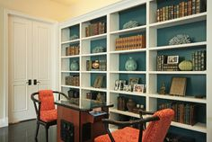 Back painted library shelves for an extra dose of color. By Jenn Feldman Designs