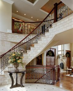 MDK Design Associates, melanie@mdkdesigns.com. French Limestone floating staircase. All tile was custom cut with pewter inserts. For more info please contact melanie@mdkdesigns.com