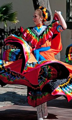 Mariachi dancer at La Villita. La Villita hosts upscale shops and galleries.