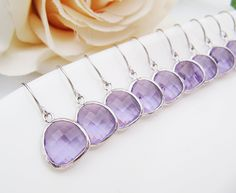 SET of 6 Wedding Jewelry Bridesmaid Jewelry Bridal Earrings Bridesmaid Earrings Dark Lilac Lavender Purple Glass rodium Trimmed Earrings. $100.98, via Etsy.