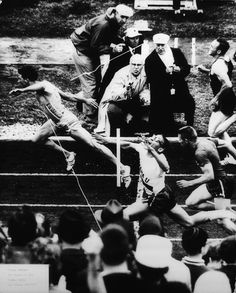 Photographer/Creator  Thomas DeFeo  Collection  1964  Publisher  Des Moines Register & Tribune  Caption/Description  Photograph of a runner pushing in front of fellow runners to win the race.