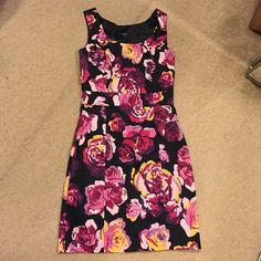 Express floral sheath dress Side zip lined sleeveless dress with rear slit. Used once colors are still vibrant Express Dresses