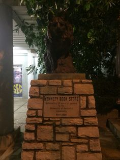 Statue outside of Kennedy's bookstore representing 50 years of service to University of Kentucky community placed in April 2000
