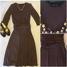 """BCBGMaxazria brown dress. BCBGMaxazria brown dress.  Waist 28"""". Shoulder to hem 44"""". Minor fade but really have to look to see.  Wrap tie at waist. Low cut neck line.  Polyester. Effortless chic and timeless. BCBGMaxAzria Dresses Midi"""