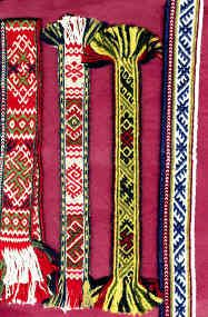 from different districts of Latvia from the 19th century. From left to right: From Bauska district is a border from a poncho-like garment called a villaine. Band from Liivani district. Another border from a villaine from Krustpils district. Border from a white woolen skirt from Abrene district.(by Inese Krūmiņa; weavershand)