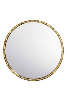Round mirror with a bamboo-look metal frame. Loops at back for hanging. Screws not included. Diameter 11 in. Diy Home Accessories, Decorative Accessories, Cosmopolitan, Cottage Hallway, Bamboo Mirror, Mirror Mirror, Small Studio Apartments, Hm Home, European Home Decor