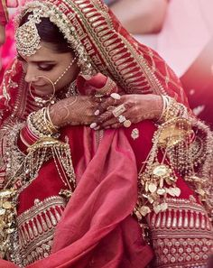 The first pictures from Ranveer Singh and Deepika Padukones weddings are out and Deepika looks like the most beautiful bride ever. Indian Bridal Outfits, Indian Bridal Lehenga, Red Lehenga, Red Bridesmaids, Red Bridesmaid Dresses, Wedding Dresses, Bollywood Wedding, Indian Wedding Photography, Photography Ideas