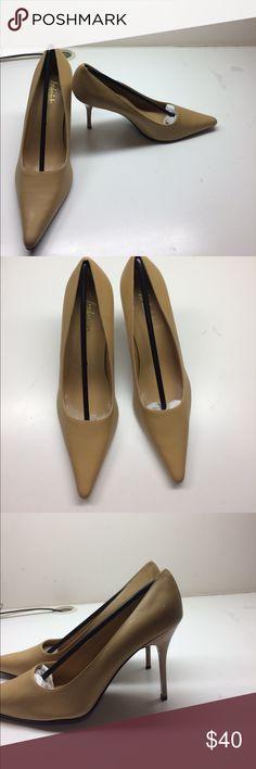 Elegant tan heels Elegant tan heels that have never been worn. Frederick's of Hollywood Shoes Heels