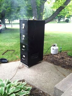 Who knew the same file cabinets that hold some of the most important information… Build A Smoker, Diy Smoker, Barbecue Smoker, Homemade Smoker, Backyard Smokers, Charcoal Smoker, Best Charcoal, Mesquite Wood, Cooking Stove