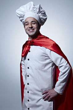 Portrait of a male chef wearing a cape standing with arms akimbo and smiling Cape, Arms, India, Stock Photos, Portrait, How To Wear, Mantle, Cabo, Delhi India