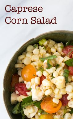 Caprese Corn Salad ~ Fresh corn and tomato salad with fresh corn, garden tomatoes, basil, Mozzarella, scallions and a vinaigrette. ~ SimplyRecipes.com