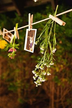 Clothes Line Pins Holding Pics and Flowers - Irina this would be a quick and easy thing to do last minute with left over flowers etc if need more decorations once we've set up. I'll get some pegs!