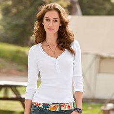 """LACEY HENLEY--The henley goes girly with a lace-inset back yoke and sparkling Swarvoski crystal buttons. Casual never looked so pretty. Cotton. Hand wash. Imported. Sizes XS (0 to 2), S (2 to 6), M (6 to 8), L (10 to 12), XL (14). Approx. 26-1/2""""L."""