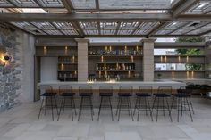 Project on the island of Naxos with our antique Mystras stone floors. Stone Flooring, Restaurant Bar, Floors, Island, Antiques, Table, Projects, Furniture, Home Decor