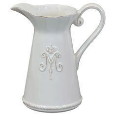 Ceramic pitcher with ruffled rim and crown embossment.   Product: PitcherConstruction Material: Ceramic