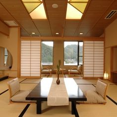 Furniture : Japanese Room Decoration Ideas Come With Black Stained Wooden Table With Cream Table Cloth And Also Wood Sliding Door Plus Wooden Floor Seating With Brown Cushion And Wood Rug Floor - Interior Japanese Room Design