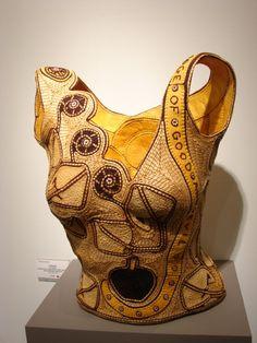 """Jan Hopkins """"Forbidden"""" Grapefruit peel, cantaloupe peel, yellow cedar bark, ostrich shell beads, waxed linen 18 x 15 x 9"""" Jane Sauer Gallery"""
