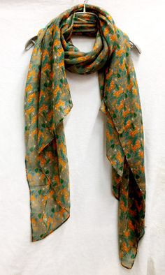 Unique and beautifully handcrafted woodland fox grey scarf. This scarf drapes beautifully is a perfect accessory for Spring & Summer / Autumn seasons,the fabric is soft and lustrous,large enough to be worn as a shawl over an evening dress / day wear and light enough to scrunch into a comforting scarf.  S I Z E : 180 cm X 100 cm  C A R E : Washing Instructions: Hand wash in cold water. Dry flat or line dry.  D E S C R I P T I O N : We use high quality viscose/polyester/...