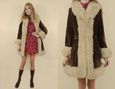 The coat of your dreams!!! Vintage late 1960s early 1970s beautiful chocolate brown suede coat with fluffy faux fur trim. Hook eye closure in the