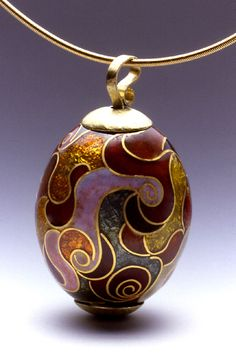 Erica Druin Enamels.  From the article pictured on her site it appears as through Erica is a self taught jewelry maker who's mother's work in enamel encouraged her own.