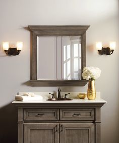 Withcabinetmouldings that allow the light to play over fine cabinet stains and rich glazes, this high-style furniture suite leads to a place of grand, graceful living. Matching mirror and bathroom vanity cabinet from Omega Cabinetry in Quartersawn Oak wood. #OmegaBathCollection