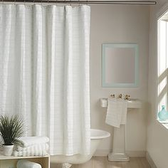 Add a dash of style to your bathroom with the DKNY Urban Dash Shower Curtain. The shower curtain features a refined white-lined pattern that allows it to blend seamlessly into any type of bathroom décor. It is made of cotton for added luxury.