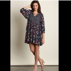 Floral Dress Brand New without tags. To small for my 40C chest. Does not close. Umgee Dresses Midi