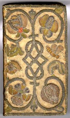 Embroidered Binding  BIBLE, London: 1643  Front cover  A charming design of flowers, snails and butterflies embroidered mainly in metallic thread on a base of white or cream satin.