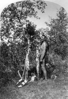 Ute man with young eagle. 1871-1875