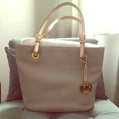 Michael Kors: Light Grey Leather Tote NWT! Beautiful Light Grey Leather Tote Bag. Leather Shoulder Straps and Gold Accents. Michael Kors Bags Totes